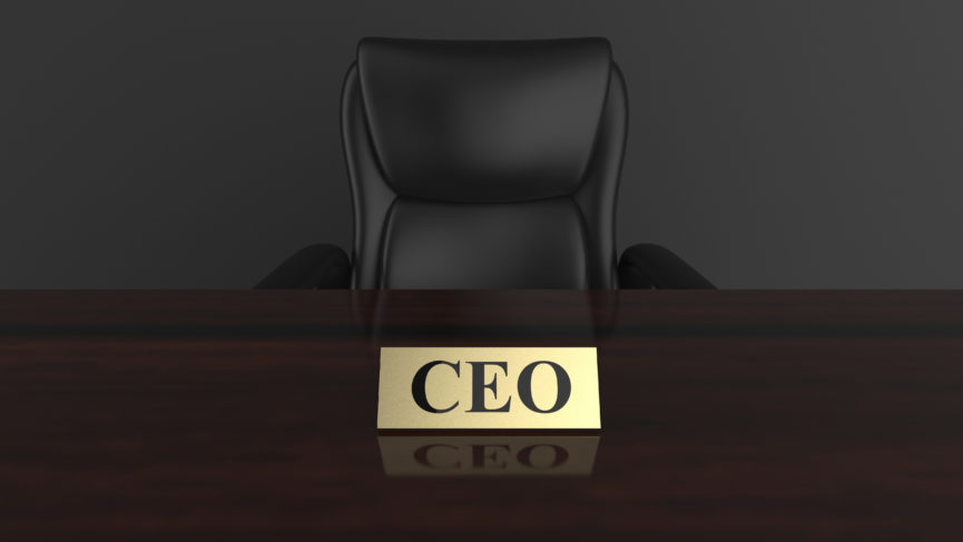 empty boardroom chair at a meeting table with a CEO nameplate on display